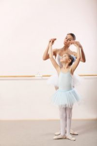 Teacher with ballet student