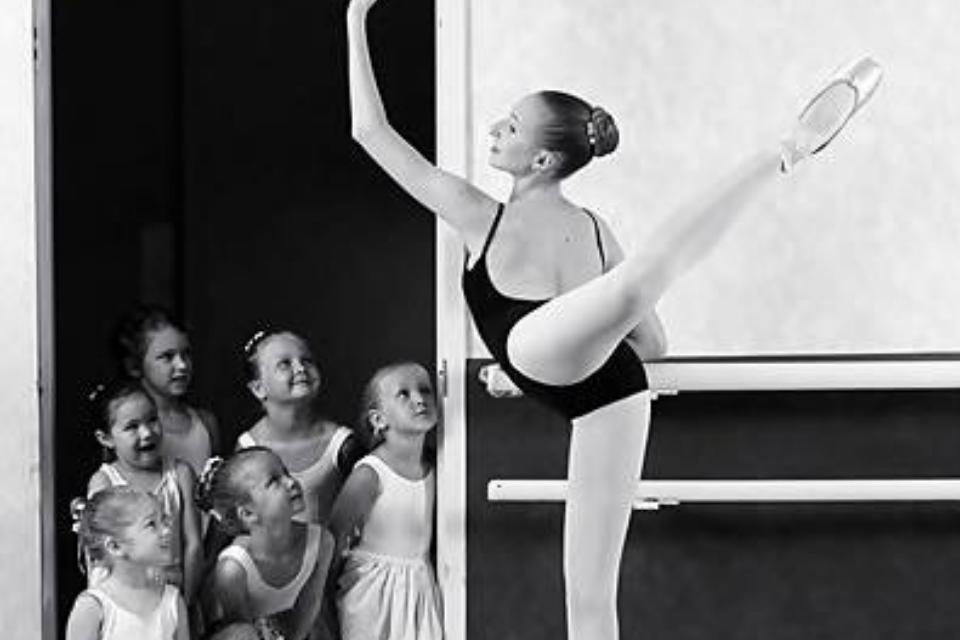 Little girls watching ballerina