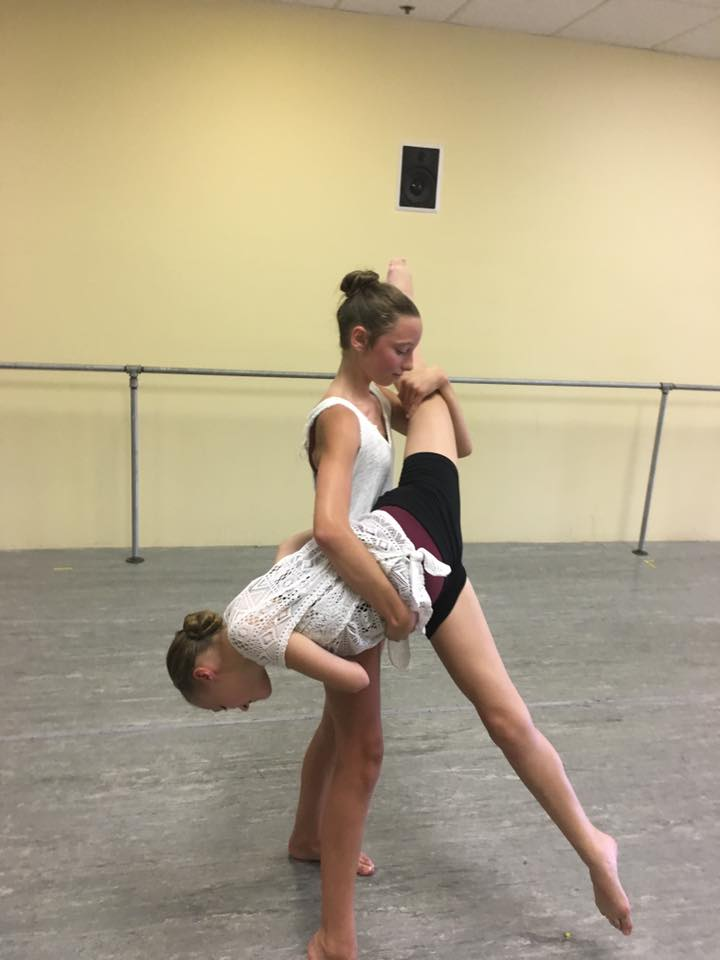 Sydney and Keira lift in Dance Class