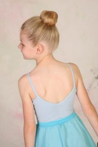 Young ballet girl with ballet bun hairstyle