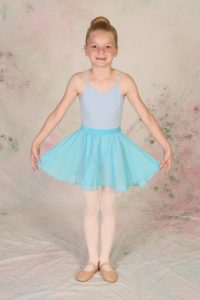 young girl in dress code for ballet and tap